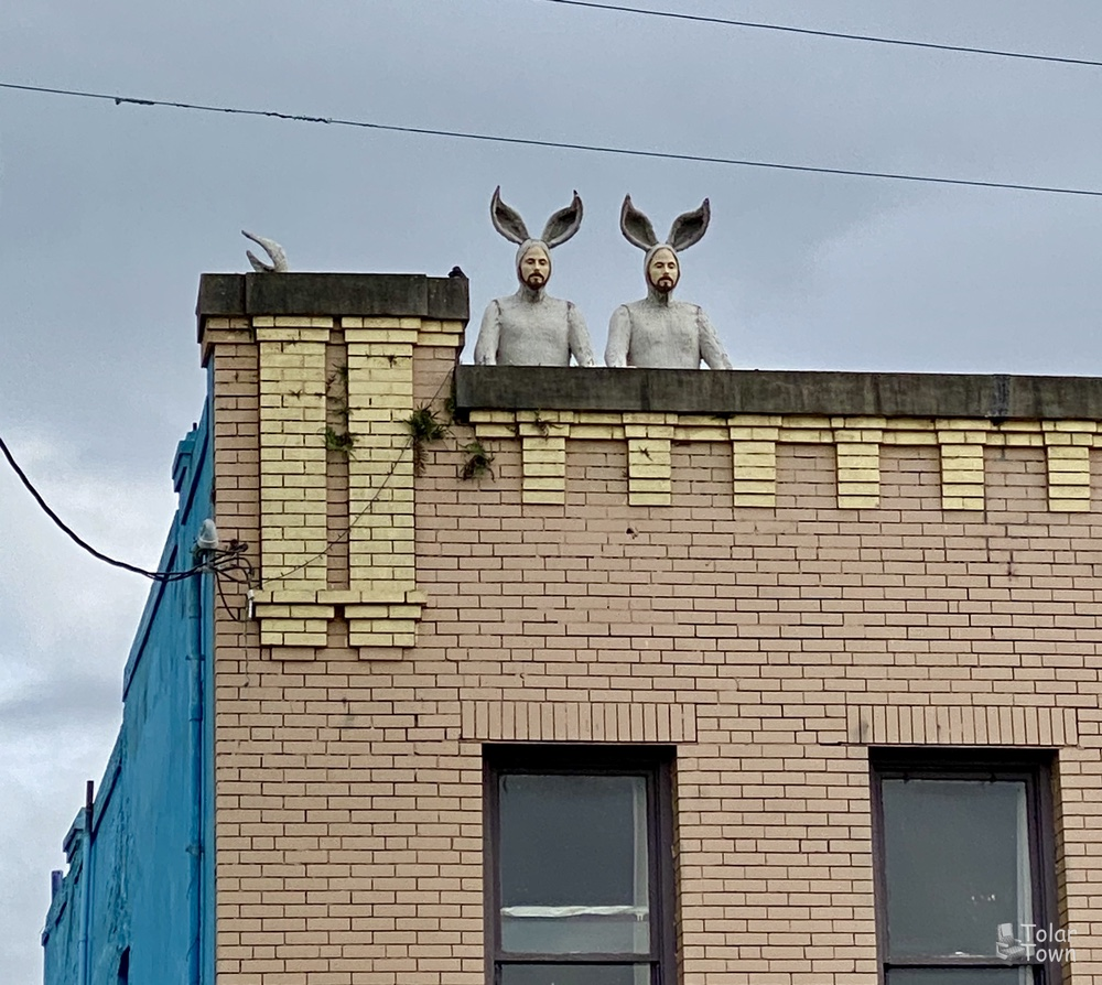 Bunnymen statues on top of a building